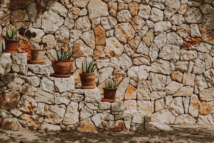 View of stone wall and rocks against building