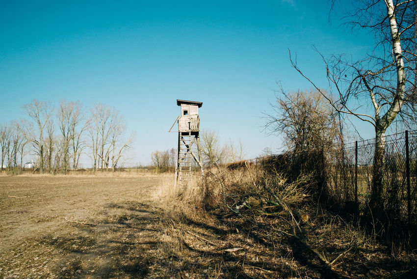 Trip to northern out of Berlin Agriculture Field Hunter Landscape_Collection Nature Architecture Bare Tree Blue Clear Sky Day Environment Field Hunting Tower Land Landscape Nature No People Non-urban Scene Outdoors Plant Sky Sunlight Tranquil Scene Tranquility Tree
