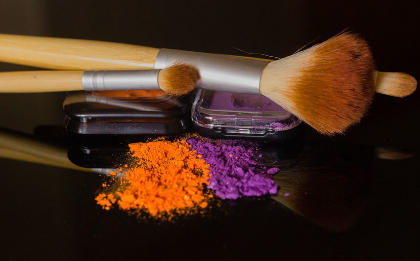 Close-up of beauty products on table