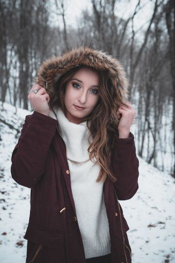 Winter Snow Cold Temperature One Person Warm Clothing Beautiful Woman Young Adult Looking At Camera Long Hair Portrait Outdoors Nature Lifestyles Jacket Weather
