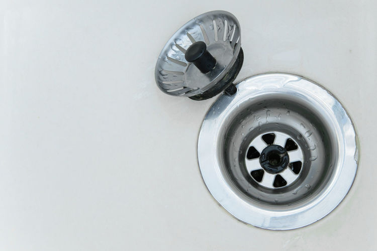 Close-up of drain in bathroom sink