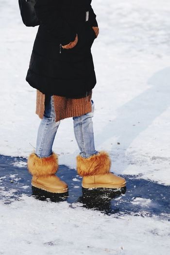 Low Section One Person Real People Outdoors Snow Woman Winter Day Standing Human Leg Lifestyles Cold Temperature Human Body Part Road Adult Adults Only People Ice Skate