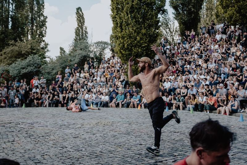 Dancing In Public Berlin Berlin People Mauerpark Mauerpark People Breakdance Breakdancing Crowd Large Group Of People Group Of People Men Real People Enjoyment Tree Lifestyles Fun Leisure Activity Nature Adult Males  Performance Day Celebration