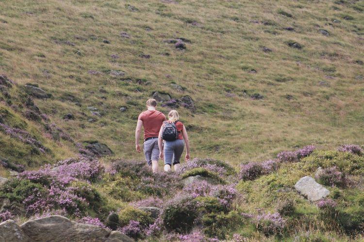 Couple Walking On Countryside Landscape