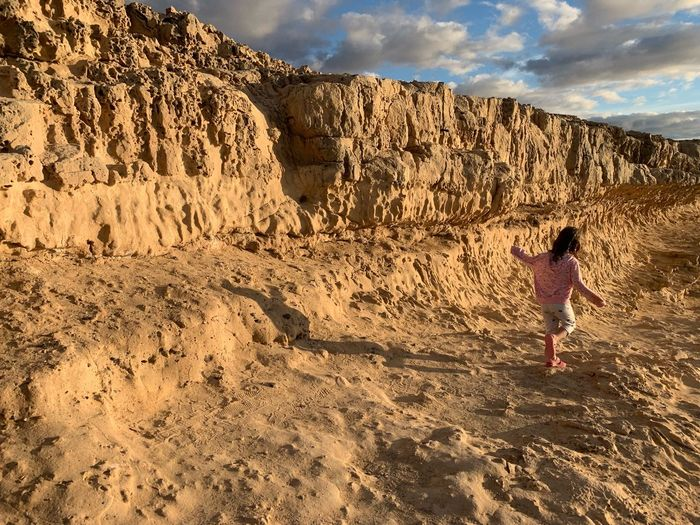 Real People One Person Sky Lifestyles Leisure Activity Land Cloud - Sky Child Women Childhood Full Length Nature Standing Sunlight Rear View Men Beach Beauty In Nature Sand Outdoors