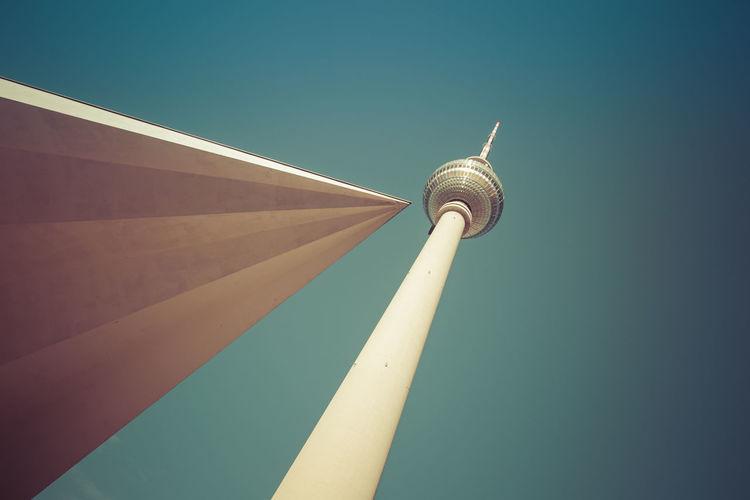Low angle view of berlin tv tower against clear sky