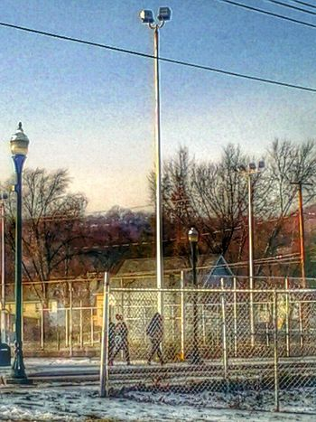 Streetphotography .. Thru The Fence