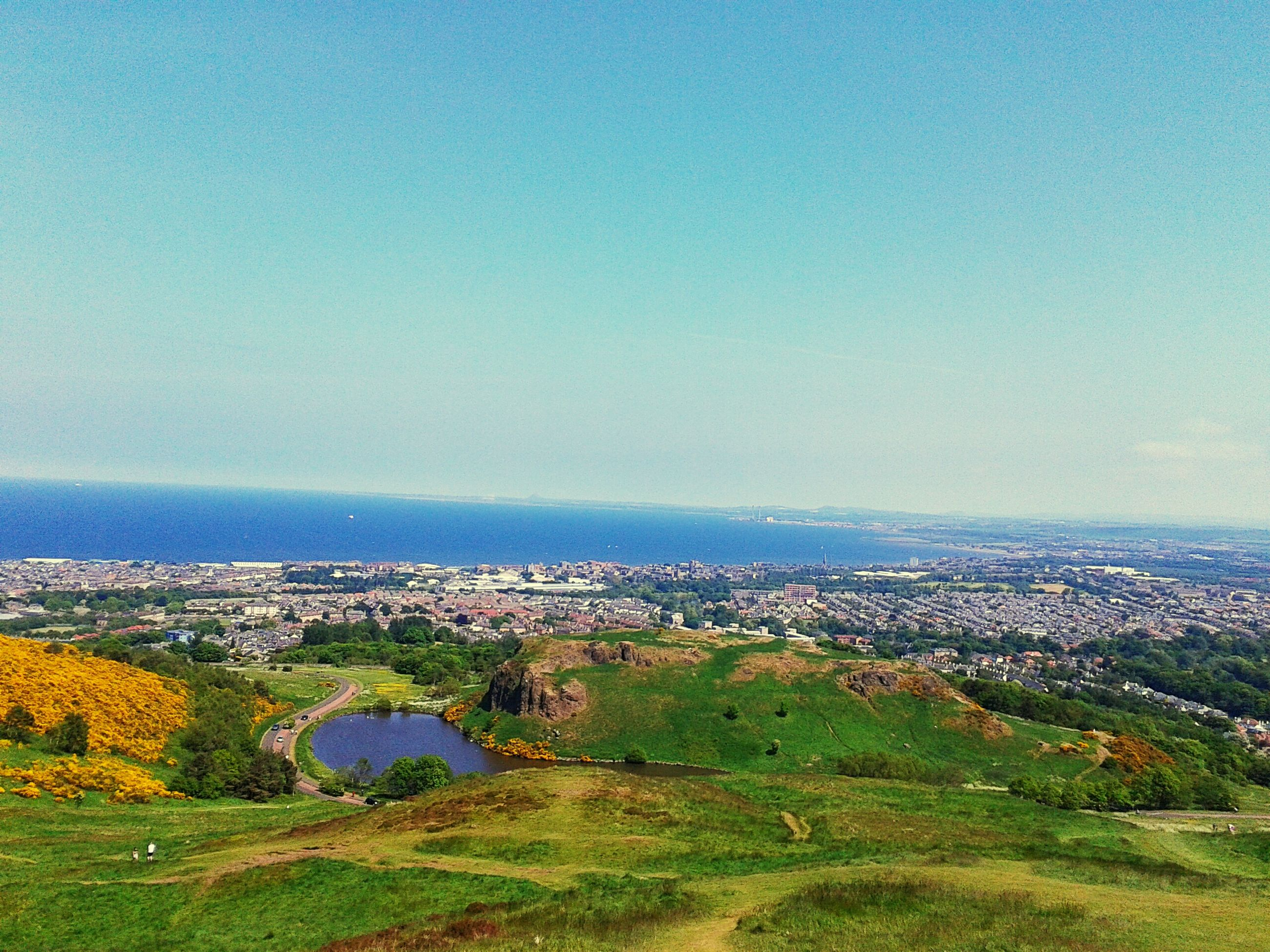 landscape, cityscape, high angle view, building exterior, copy space, clear sky, architecture, built structure, aerial view, scenics, blue, sea, city, horizon over water, crowded, tranquil scene, residential district, tranquility, beauty in nature, nature
