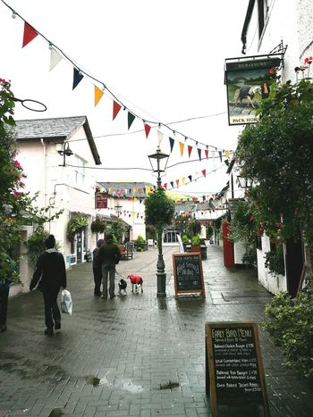 Outdoors Village Village Life Bunting Bunting Flags Adult Day People Sky lamppost