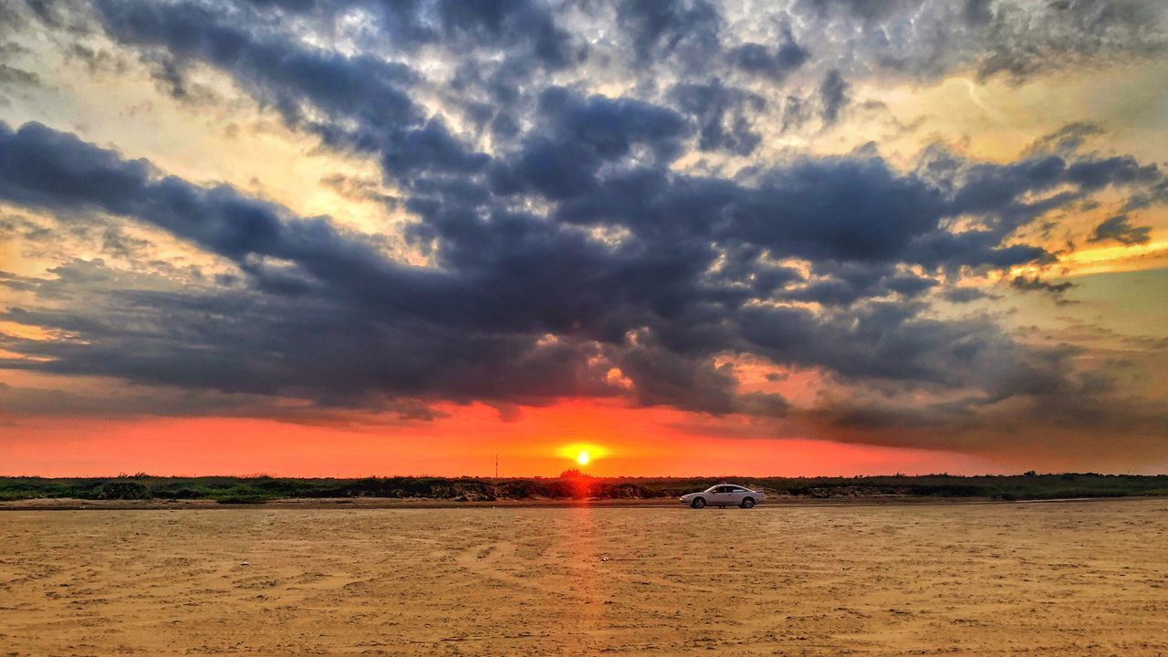 sky, cloud - sky, sunset, scenics - nature, beauty in nature, orange color, sea, water, nature, no people, tranquility, tranquil scene, beach, land, sun, non-urban scene, mode of transportation, outdoors, dramatic sky