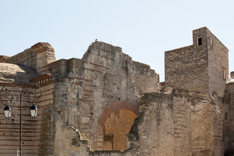 Low angle view of old ruin building against clear sky
