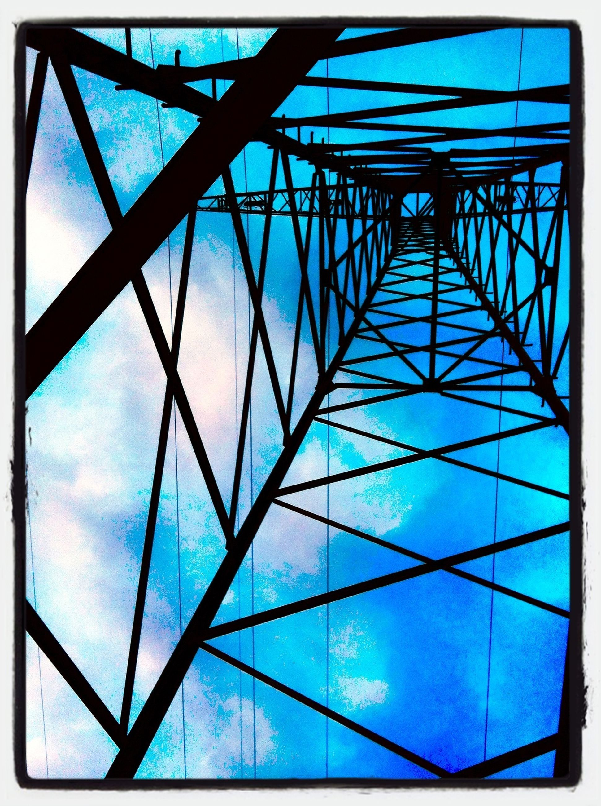 low angle view, transfer print, sky, blue, auto post production filter, built structure, glass - material, architecture, cloud - sky, cloud, indoors, day, directly below, metal, pattern, reflection, connection, no people, grid, transparent