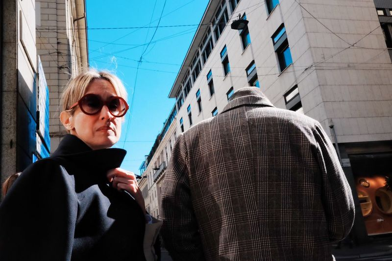 Mid adult woman wearing sunglasses in city