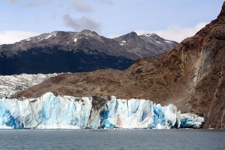 Spectacular mountain range with ice formed at the bottom