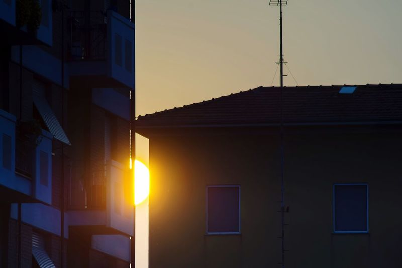 Architecture Built Structure Building Exterior Sunset Dusk Illuminated No People Sky Outdoors Silhouette Modern Nature Night Sunset Parma Parma Italy Twilight Sun Between Houses Yellow Popular Calm End Endlessness