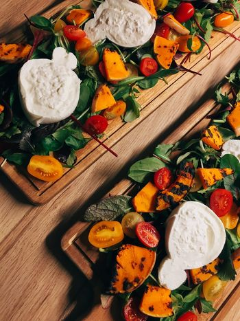 Buratta, grilled butternut squash on a bed of salad. Food Porn Food And Drink Merry Christmas Berliner Ansichten Rustic Vegetable Colorful Colorful Food Salad Dinner Cheese Italian Italian Food Food Food And Drink Vegetable High Angle View Cutting Board Multi Colored No People Bowl Healthy Eating Freshness Pumpkin Egg Yolk Ready-to-eat