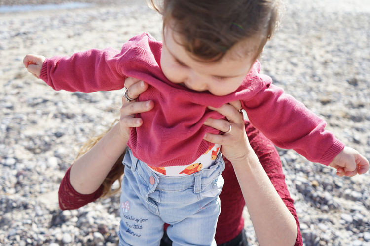 Full length of cute girl on beach