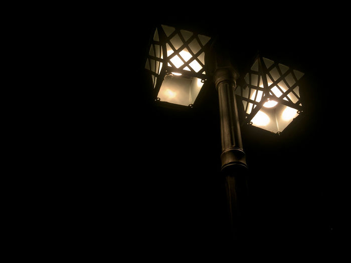 Low Angle View Of Illuminated Street Light Against Clear Sky At Night