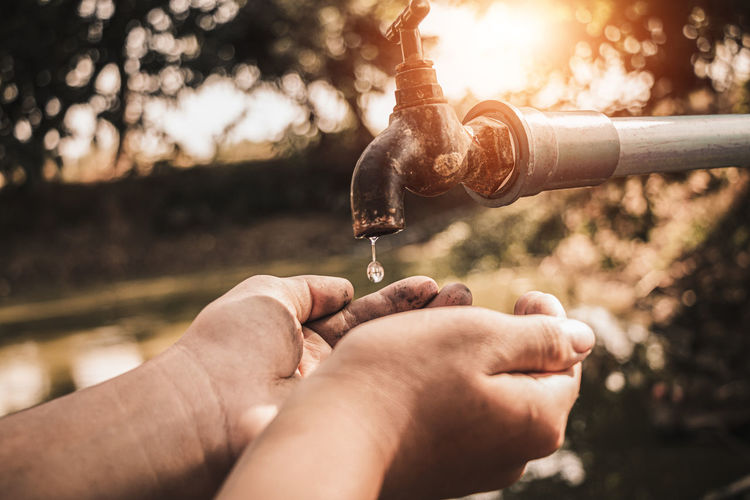 Close-up of hands holding water