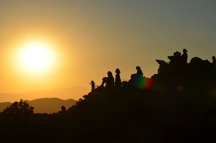 Tribe Reconciliation Achievement Squat Sunset_collection Achievements Beauty In Nature Goal Group Of People Large Group Of People Leisure Activity Mountain Nature Orange Color Outdoors Reaching Real People Scenics Silhouette Sun Sunlight Sunset Team Together Togetherness Top Of The Mountains Tribe