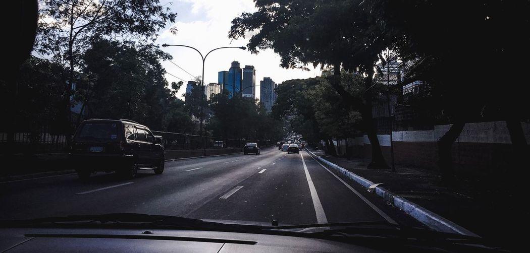 Cars on street seen through windshield