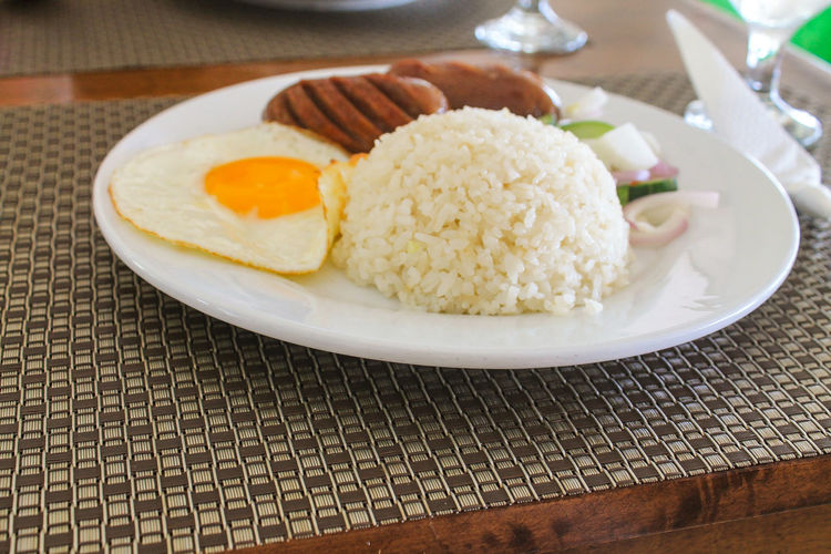 Food and travel. Longgisilog. Filipino breakfast of Longganisa, rice and egg Longganisa Longanisa Travel Photography Travel Filipino Food Filipino Breakfast Longsilog Summer Vacation Food And Travel Foodie Food Photography Egg Yolk Fried Egg Plate Breakfast Sunny Side Up Egg Close-up Food And Drink Rice - Food Staple Fried Serving Dish