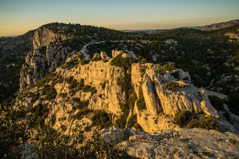 marseille,calanque,bouche du rhone, france Rock Sky Rock - Object Mountain Scenics - Nature Solid Beauty In Nature Tranquility Tranquil Scene Nature Rock Formation No People Non-urban Scene Landscape Environment Geology Mountain Range Idyllic Remote Sunset Outdoors Formation Mountain Peak Eroded