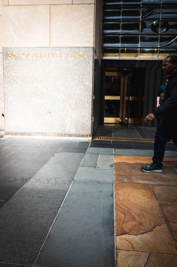 Side view of man walking on floor