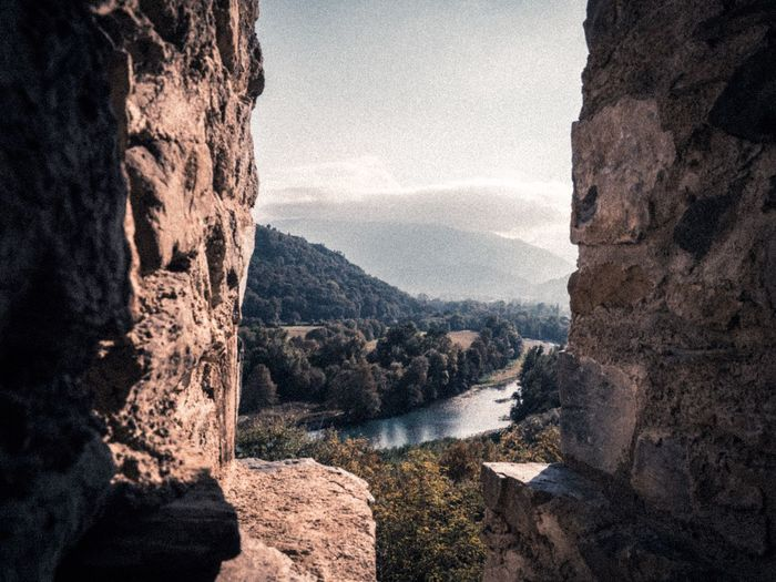 Ruins Of A Castle Ruins Ruins Architecture Pyrénéesorientales Pyrenees Lourdes EyeEm Selects Water Tranquility Tree Beauty In Nature Nature Mountain Scenics - Nature No People Tranquil Scene Rock Day Outdoors Rock - Object Solid Plant Sky River Mountain Range Non-urban Scene