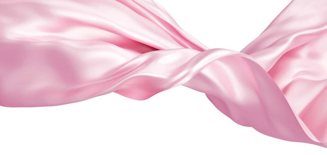 Close-up of pink petals against white background
