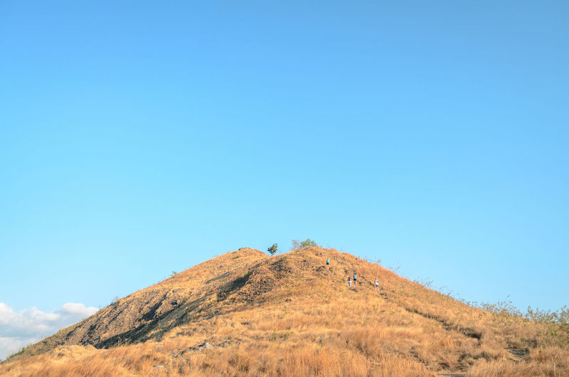 A hill with blue sky in the background, at labuan bajo, east nusa tenggara, indonesia