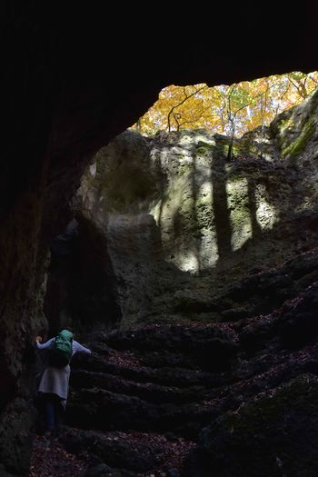 Adventure Beauty In Nature Cave Geology Hiking Hole Hole In The Ground Mountain Nature Physical Geography Rear View Rock - Object Rock Formation Fränkische Schweiz, DE Fränkische Schweiz
