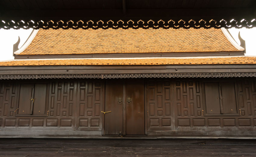 the dark brown beautiful house was built in Thai style Thai House, Architecture Building Exterior Built Structure Dark Brown Nature No People Outdoors Roof Roof Tile