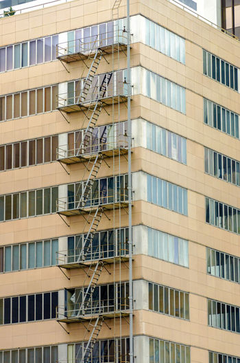 Fire escape climbing up a tall building in downtown Portland, Oregon America Aparment Architecture Building Business Center City Cityscape Downtown Exterior Landmark Metropolis Modern Northwest Oregon Outodoors Pacific Portland Skyline Structure Tourism United States Urban USA View