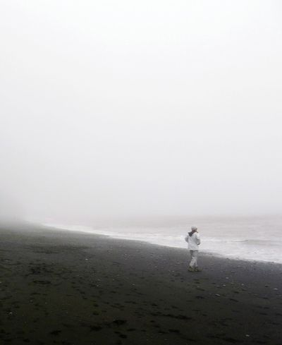 Fog Iceland Iceland Trip Iceland_collection Reynisfjara Black Sand Beach Black Sand Beach Iceland Sea Beach Water One Person Outdoors Vacations Day Sand Horizon Over Water Nature One Man Only Wave Beauty In Nature Sky