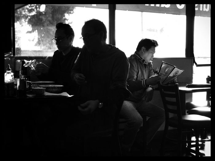 I took this in the early morning which is how I got the great light. I decided to go with a black and white look to contrast the men sitting back to back. One in light, two in darkness. Black & White Black And White Black And White Photography Cafe Day Indoors  Men Real People Sitting Table Togetherness