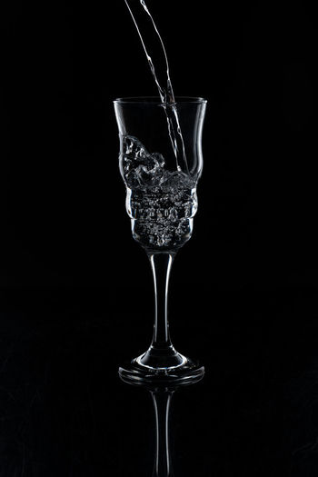 Dark Field Water Pouring Black Background Studio Shot Glass Food And Drink Drink Refreshment Splashing Motion Indoors  Water Food Drinking Glass No People Transparent Household Equipment Cut Out Cocktail Alcohol Martini Glass Martini Purity