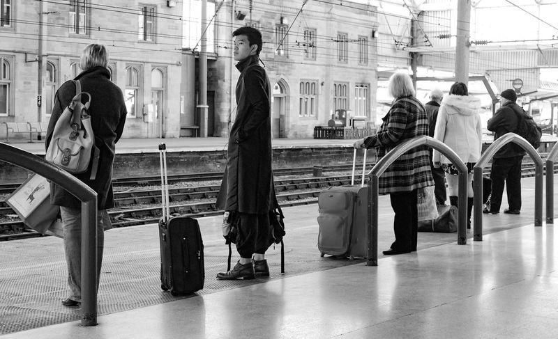Black And White Everyday Life Bnw Lifestyles Public Transportation Shoes No Socks In Winter Standing Train Journey Train Station