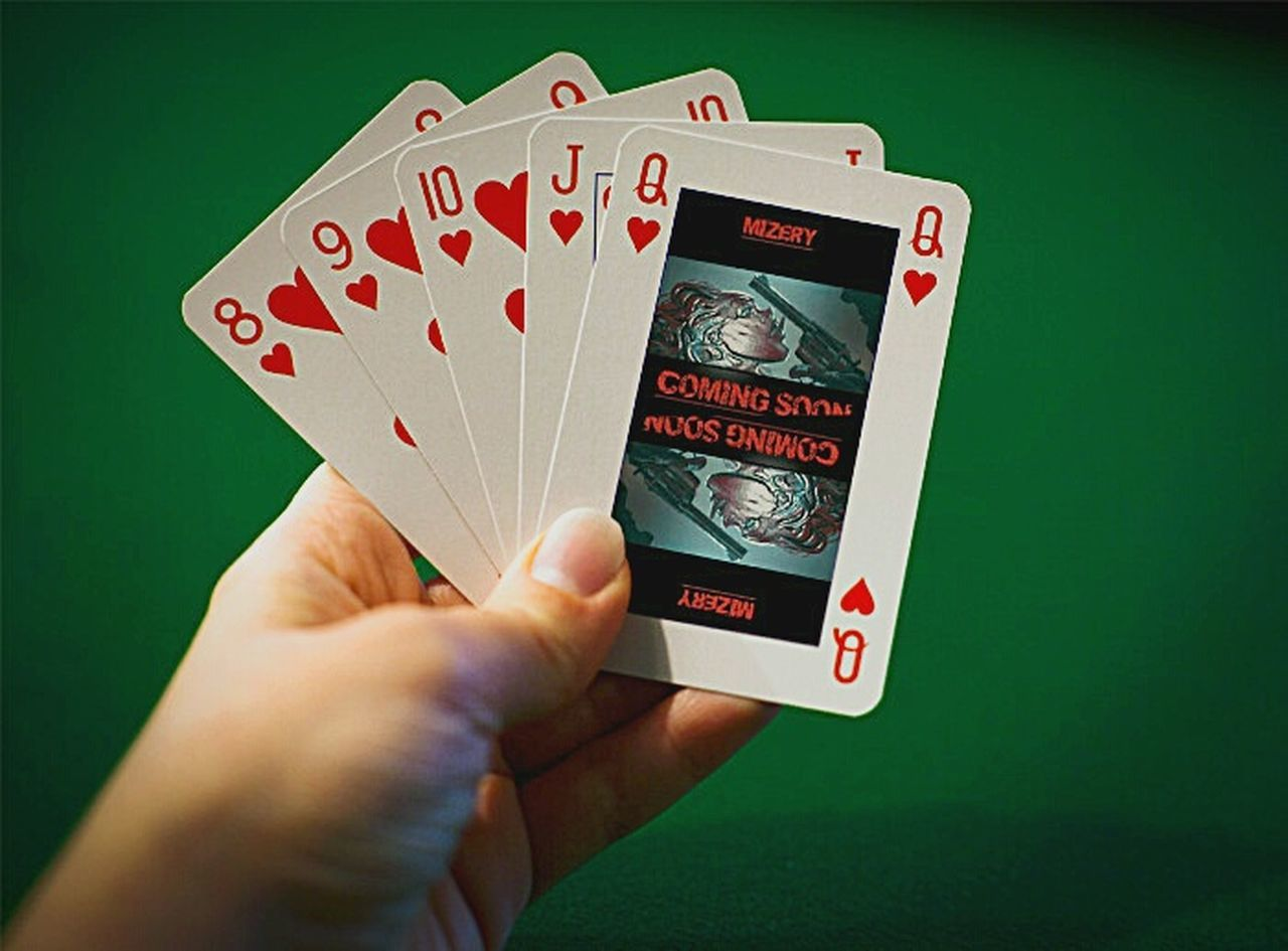 human hand, human body part, gambling, portable information device, holding, playing, wireless technology, cards, smart phone, leisure games, adult, internet, chance, people, close-up, one man only, photography themes, one person, indoors, adults only, day, only men