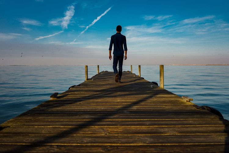 'Untitled' Pier Jetty Sea Wood - Material Cloud - Sky Sky Nature Tranquil Scene Wood Paneling Horizon Over Water Beauty In Nature Water Full Length Scenics Tranquility One Person Rear View Outdoors Real People Standing EyeEm EyeEm Best Shots EyeEm Gallery The Week Of Eyeem