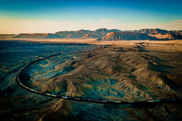 On the edge of a crumbling world Dark Desert Drone  Drone Shot Road Scenic Utah Beauty In Nature Car Day Drone Photography Dronephotography Landscape Moody Nature No People Outdoors Scenics Sky Sunset Tranquil Scene Tranquility