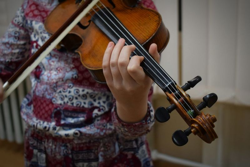 Midsection Of Woman Playing Violin