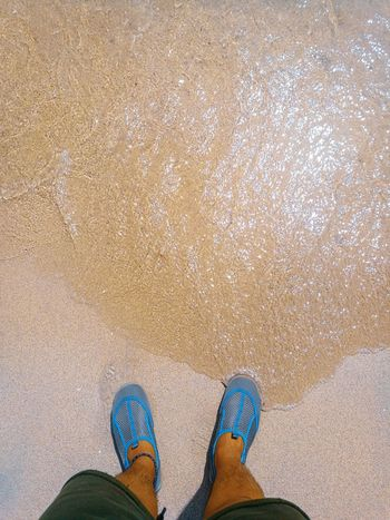 Answering the call of the Sea Low Section Beach Standing Sand Human Leg Shoe Pair Personal Perspective High Angle View Men Human Feet Pebble Beach Footwear Feet Human Human Foot Flat Shoe Things That Go Together Slipper  Trousers Sandal Flip-flop Inner Power