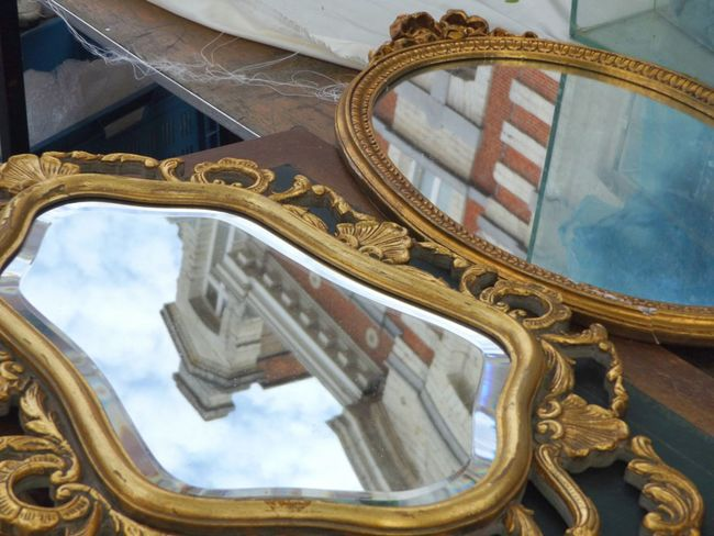 Double Trouble. Mirror Reflection Mirror Architecture Perspectives Showcase June Live Love Shop Street Fleamarket Vintage Historical Place Double Trouble Streetphotography Sky Outdoors Group Of Objects Window Reflections Day Reflection Collection Collectable Items Collectable Merchandise Collectable Art The OO Mission Hidden Gems