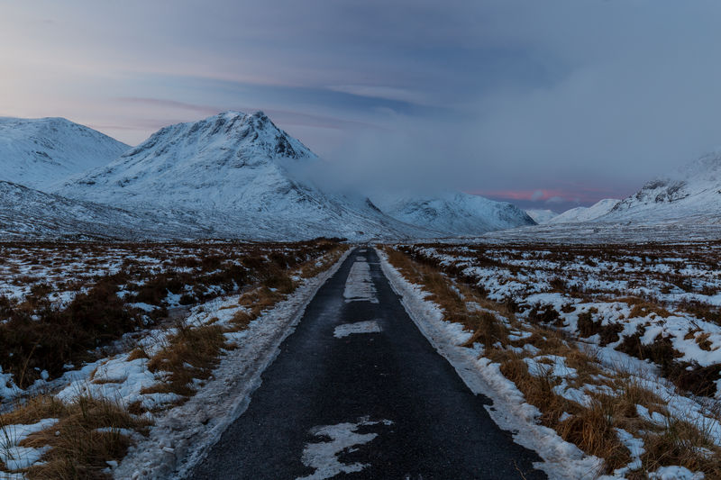 Winter snow mountain landscape in Glencoe, Scotland, UK Mountain Winter Snow Snowcapped Mountain Cold Temperature Glencoe Sky Clouds Moody Scotland Scottish Highlands Uk United Kingdom Ice Weather Nature Road Open Road Trip Roadtrip Journey Driving