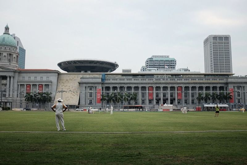 Grass Architecture Building Exterior National Gallery Singapore Urban Soulful Street Photography Social Issues Sports Cricket Field People One Person Singapore Tranquil Scene City Outdoors Grass Architecture Horizontal Person Building Exterior Cloud - Sky People Sky One Person