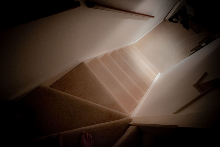 Directly below shot of illuminated staircase at home