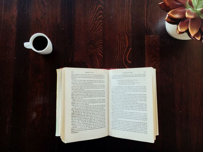 📖 EyeEm Selects Table Book Wood - Material Food And Drink Directly Above Publication Indoors  Cup No People Page High Angle View Calligraphy Coffee Text