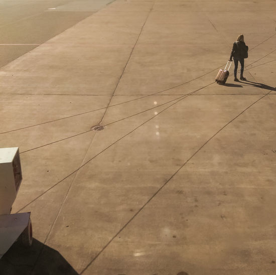 Adventure Airport Arlanda At The Airport Casual Clothing Day Disembarking High Angle View Independent  Leaving Leisure Activity Lifestyles Starting A Trip Tarmac Travel Traveler Traveling Unrecognizable Person Walking Walking Away Warm Woman