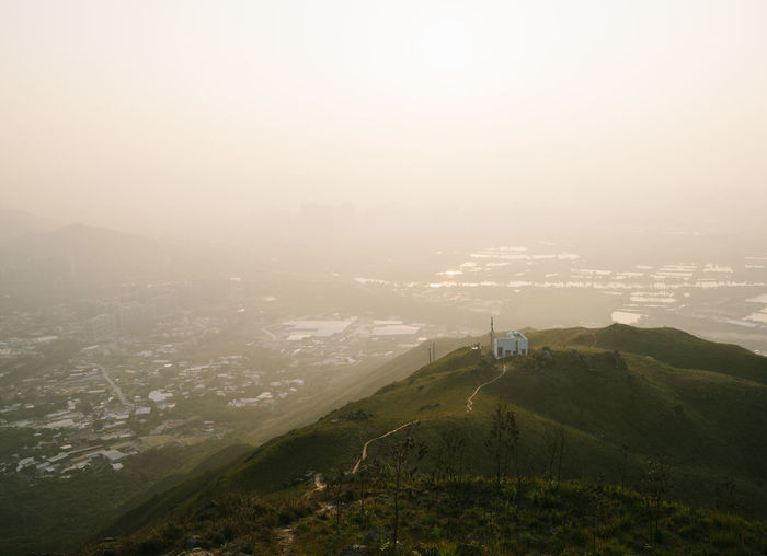 House in the smog Beauty In Nature City Cityscape Day Fog Landscape Mountain Mountain Range Nature No People Outdoors Scenics Sky Sunset Tranquility Travel Destinations Tree Flying High